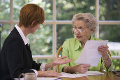 woman advising elder woman